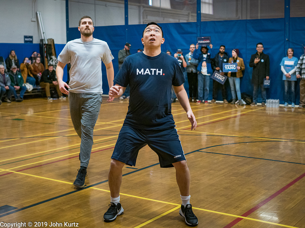 12 DECEMBER 2019 - DES MOINES, IOWA: ANDREW YANG sets up for a rebound during a basketball game with J.D. Scholten in the gym in the Ames, IA, City Hall. Scholten is an Iowa Democrat running against Republican Congressman Steve King. Yang, an entrepreneur, is running for the Democratic nomination for the US Presidency in 2020. He brought bus tour to Ames, IA, Thursday. Iowa hosts the the first election event of the presidential election cycle. The Iowa Caucuses will be on Feb. 3, 2020.       PHOTO BY JACK KURTZ