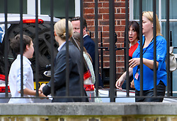 © Licensed to London News Pictures. 13/07/2016. London, SAMANTHA CAMERON appears to mouth something to her son (left) as she is seen returning to 10 Downing Street in London with her husband David Cameron (Not pictured) and David Cameron's assistant LIZ SUGGS (right) on his last day as British prime minister with Theresa May due to be sworn in as the new British prime minister. Photo credit: Ben Cawthra/LNP