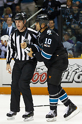 April 4, 2011; San Jose, CA, USA;  NHL linesman Brad Kovachik (left) escorts San Jose Sharks center Jamal Mayers (10) to the penalty box after fighting Los Angeles Kings left wing Kyle Clifford (not pictured) during the first period at HP Pavilion. San Jose defeated Los Angeles 6-1. Mandatory Credit: Jason O. Watson / US PRESSWIRE