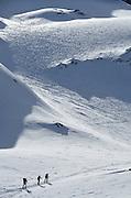 Skiers ascending slope in Austria's Otztal Alps.