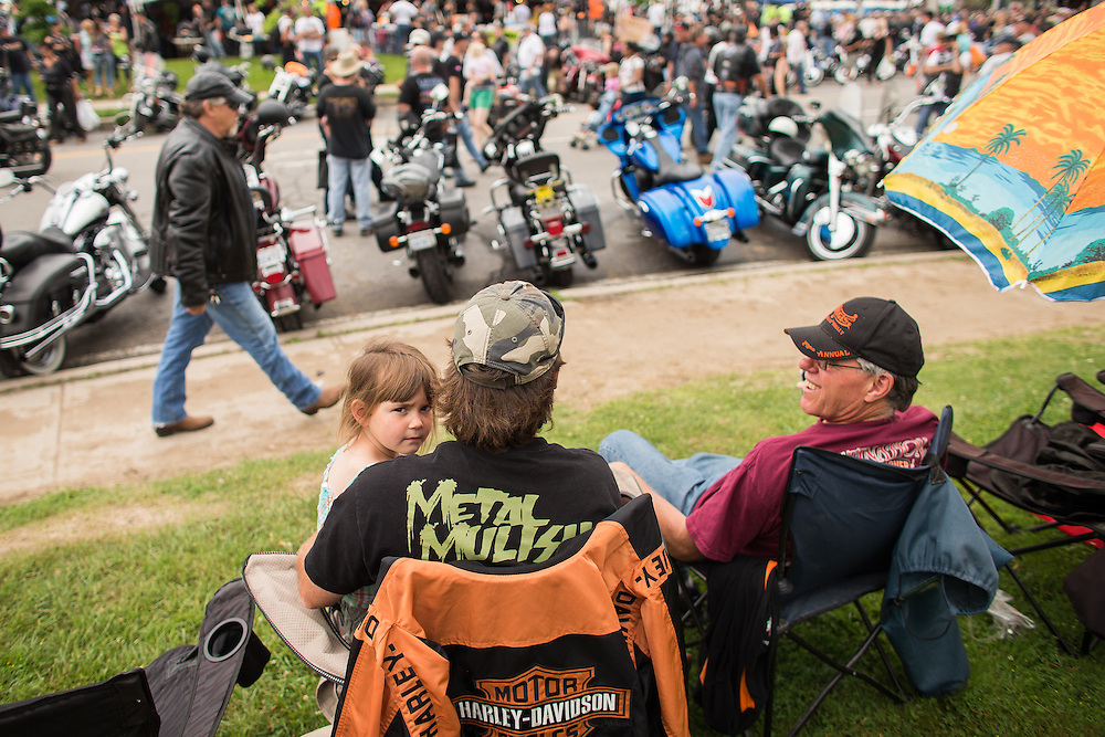 Ryan Copeland his daughter Alissa, 4, take in the sights during Friday the 13th celebrations in Port Dover Ontario, Friday,  June 13, 2014.<br /> THE CANADIAN PRESS/ Geoff Robins