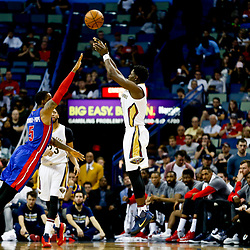 Mar 1, 2017; New Orleans, LA, USA; New Orleans Pelicans guard Jrue Holiday (11) shoots over Detroit Pistons guard Kentavious Caldwell-Pope (5) during the second quarter of a game at the Smoothie King Center. Mandatory Credit: Derick E. Hingle-USA TODAY Sports