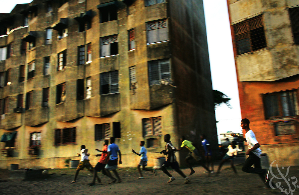 Ivorian boys play a game of street football amid housing blocks in a poor district of the Port Bouet neighborhood of Abidjan, Côte d'Ivoire February 17,2006. Football is an integral part of the social fabric that makes up Ivorian society.