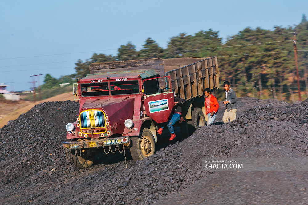 Coal Miners getting in the truck used to carry coal from West Jaintia Hills to Bangladesh.