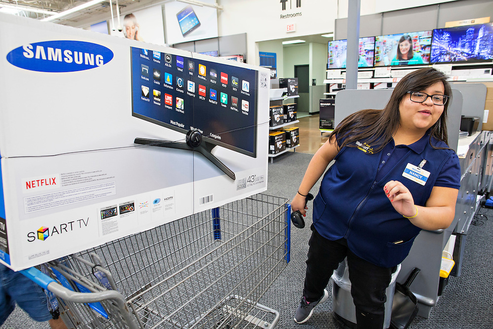 ROGERS, AR - OCTOBER 12:  Associate Nancy Guadarrama sells a new TV in the Entertainment Department at Walmart Store #4208 on October 12, 2015 in Rogers, Arkansas.  <br /> CREDIT Wesley Hitt for Wall Street Journal<br /> WALSQUEEZE