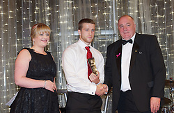 CARDIFF, WALES - Monday, October 8, 2012: Wales' Adam Matthews receives the Young Player of the Year Award from St. David's Hotel's Amy Beecham and FAW President Trevor Lloyd-Hughes during the FAW Player of the Year Awards Dinner at the National Museum Cardiff. (Pic by David Rawcliffe/Propaganda)