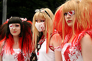"Costume Play Bloody Nurses. A wide variety of ""costume play"" getups are shown here: goths, cartoon characters from Japanese manga, anime,  the sweet-and-innocent frilly look or combinations in between (goth lolly)  Every Sunday, these cosplay characters converge on Harajuku, Tokyo's fashion quarter. Most casual observers say that cosplay is a reaction to the rigid rules of Japanese society. But since so many cosplay girls congregate in Harajuku and Aoyama - Tokyo headquarters of Fendi, Hanae Mori and Issey Miyake, others consider it is a reaction to high fashion. Whatever the cause, cosplay aficionados put a tremendous amount of effort into their costumes every Sunday. One wonders what they wear on Monday morning..."