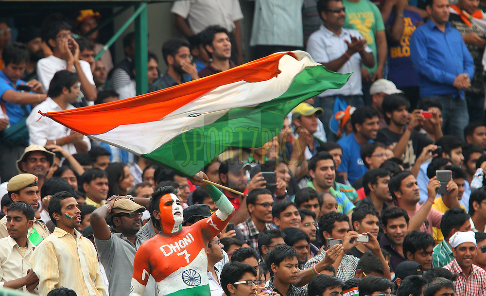 Indian fans cheer for Sachin Tendulkar of India during day 3 of the 4th Test Match between India and Australia held at the Feroz Shah Kotla stadium in Delhi on the 24th March 2013..Photo by Ron Gaunt/BCCI/SPORTZPICS ..Use of this image is subject to the terms and conditions as outlined by the BCCI. These terms can be found by following this link:..http://www.sportzpics.co.za/image/I0000SoRagM2cIEc