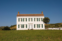 Historic Johnston House, New  England style saltbox house, in Half Moon Bay, from 1853, .San Mateo Coast of California, south of San Francisco.  Photo copyright Lee Foster, 510-549-2202, lee@fostertravel.com, www.fostertravel.com. Photo 449-30984