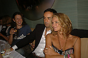 Katie Grand, Elle MacPherson and Francisco Costa. Natalia Vodianova and Elle Macpherson host a dinner in honor of Francisco Costa (creative Director for women) and Italo Zucchelli (creative director for men)  of Calvin Klein. Locanda Locatelli, 8 Seymour St. London W1. ONE TIME USE ONLY - DO NOT ARCHIVE  © Copyright Photograph by Dafydd Jones 66 Stockwell Park Rd. London SW9 0DA Tel 020 7733 0108 www.dafjones.com