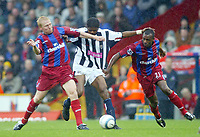 23/10/2004<br />FA Barclays Premiership - Crystal Palace v West Bromich Albion - Selhurst Park<br />Crystal Palace's Aki Riihilahti (l) and Emmerson Boyce combine to take the ball from West Bromich Albion's Kanu.<br />Photo:Jed Leicester/Back Page Images