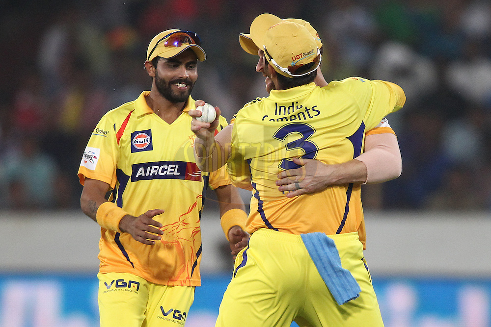 Ravindra Jadeja of the Chennai Super Kings and Suresh Raina of the Chennai Super Kings congratulate Brendon McCullum of the Chennai Super Kings for taking the catch to get Virender Sehwag of the Kings XI Punjab wicket  during the second semi final match of the Oppo Champions League Twenty20 between the Kings XI Punjab and the Chennai Superkings held at the Rajiv Gandhi Cricket Stadium, Hyderabad, India on the 2nd October 2014<br /> <br /> Photo by:  Shaun Roy / Sportzpics/ CLT20<br /> <br /> <br /> Image use is subject to the terms and conditions as laid out by the BCCI/ CLT20.  The terms and conditions can be downloaded here:<br /> <br /> http://sportzpics.photoshelter.com/gallery/CLT20-Image-Terms-and-Conditions-2014/G0000IfNJn535VPU/C0000QhhKadWcjYs