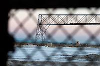 Il complesso produttivo delle saline è situato nel comune italiano di Margherita di Savoia (nome dato dagli abitanti in onore alla regina d'Italia che molto si adoperò nei confronti dei salinieri) nella provincia di Barletta-Andria-Trani in Puglia. Sono le più grandi d'Europa e le seconde nel mondo, in grado di produrre circa la metà del sale marino nazionale (500.000 di tonnellate annue).All'interno dei suoi bacini si sono insediate popolazioni di uccelli migratori e non, divenuti stanziali quali il fenicottero rosa, airone cenerino, garzetta, avocetta, cavaliere d'Italia, chiurlo, chiurlotello, fischione, volpoca..Scorcio degli stabilimenti visti attraverso la rete di recinzione.