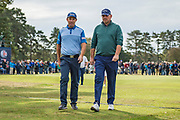 Padraig Harrington of Ireland (left) and Thomas Bjorn of Denmark in discussion during the British Masters 2018 at Walton Heath Golf Course, Walton On the Hill, Surrey on 12 October 2018. Picture by Martin Cole.