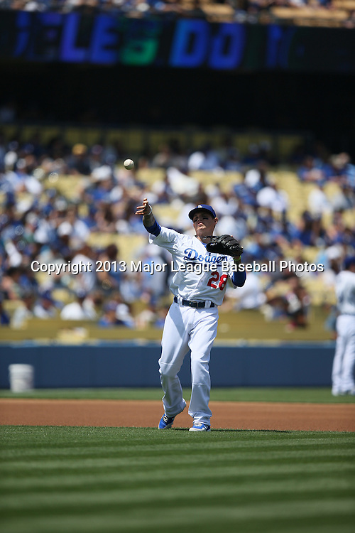 LOS ANGELES, CA - APRIL 28:  Justin Sellers #28 of the Los Angeles Dodgers plays shortstop during the game against the Milwaukee Brewers on Sunday, April 28, 2013 at Dodger Stadium in Los Angeles, California. The Dodgers won the game 2-0. (Photo by Paul Spinelli/MLB Photos via Getty Images) *** Local Caption *** Justin Sellers
