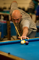 Dave Smith lines up a shot during the 12th annual 8-Ball Tournament at the Laconia Rod and Gun on Saturday.  (Karen Bobotas/for the Laconia Daily Sun)