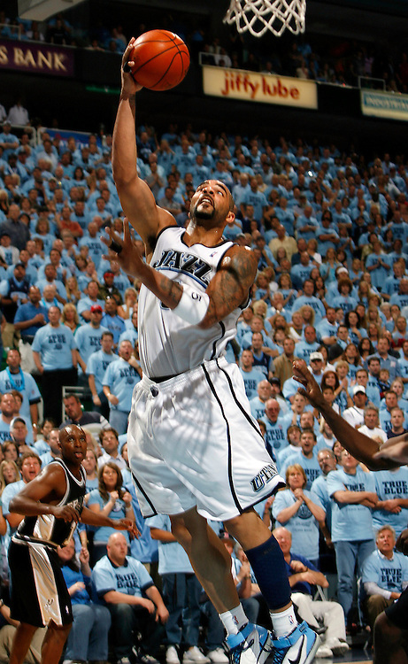 The Utah Jazz's Carlos Boozer goes up for two points against the San Antonio Spurs in game 3 of the Western Conference finals at the Energy Solutions Arena in Salt Lake City, Utah Saturday May 26, 2007.  August Miller/ Deseret Morning News