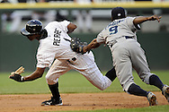 CHICAGO - JUNE 06:  Juan Pierre #1 of the Chicago White Sox is caught in a rundown and is tagged out by Chone Figgins #9 of the Seattle Mariners in the first inning on June 6, 2011 at U.S. Cellular Field in Chicago, Illinois.  The White Sox defeated the Mariners 3-1.  (Photo by Ron Vesely)  Subject:  Juan Pierre;Chone Figgins