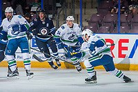 PENTICTON, CANADA - SEPTEMBER 8: Jake Kulevich #68 of Winnipeg Jets back checks Jakob Stukel #34 of Vancouver Canucks on September 8, 2017 at the South Okanagan Event Centre in Penticton, British Columbia, Canada.  (Photo by Marissa Baecker/Shoot the Breeze)  *** Local Caption ***
