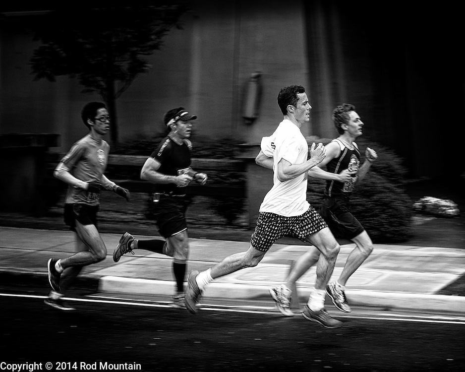 Competitors seen running along Burrard Street during the 2014 Vancouver Sun Run.The Vancouver Sun Run is an annual event sponsored by the Vancouver Sun newspaper and one of the largest road races in the world.<br />