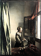 Young Womnan Reading a Letter at an open Window' c1657. Oil on Canvas. Jan Vermeer (1632-1675) Dutch Baroque painter.   Casement Leaded-lights Textile Carpet Curtain