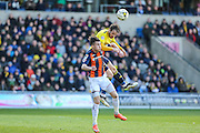 Luton Town's Dan Potts and Oxford United's Danny Hylton challenge for the ball during the Sky Bet League 2 match between Oxford United and Luton Town at the Kassam Stadium, Oxford, England on 16 April 2016. Photo by Shane Healey.