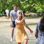 UK Weather: A group of people playing rounders as Heatwave continues in Hype park, London, UK. July 26 2018.
