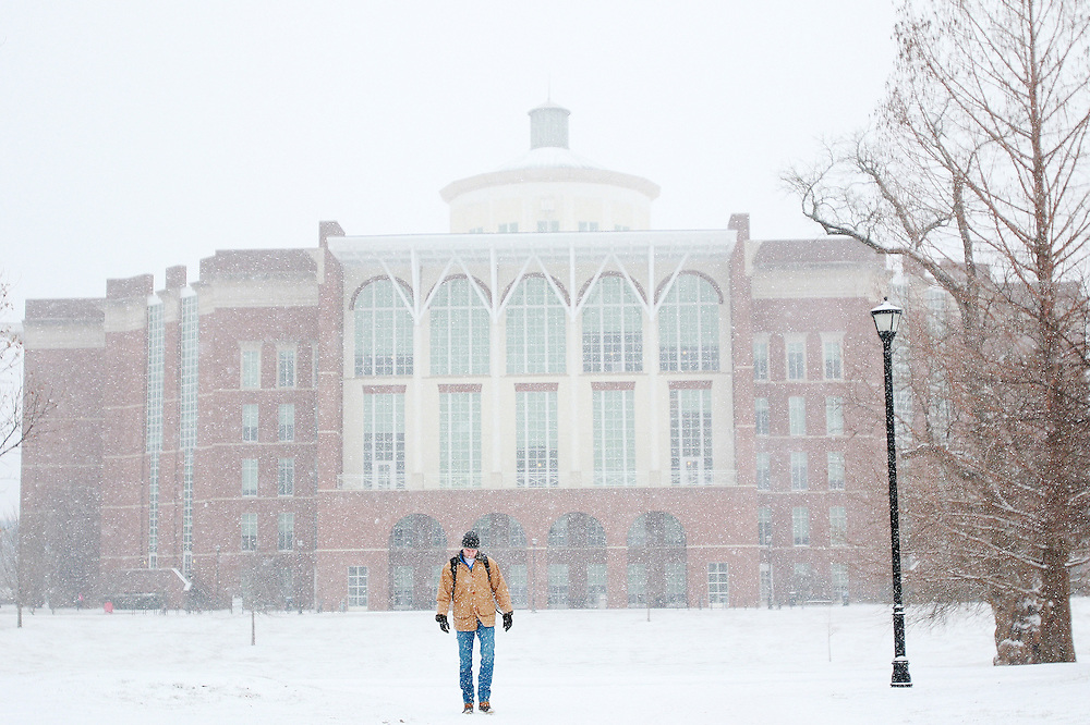 "A University of Kentucky student trudges through the snow on Wednesday, January, 20, 2016. 1""-2"" inches fell overnight and into the morning but didn't cancel class."