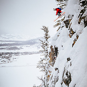 Andrew Whiteford drops a monster cliff in the backcountry of the Tetons near Jackson Hole Mountain Resort.