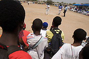 Ghanaian children gather to watch an exhibition baseball game in the city of Tema, roughly 35 km east of Ghana's capital Accra on Saturday February 3, 2007. The game was being held on the occasion of the visit of a delegation from the American Major League Baseball Association made possible by the African Development Foundation, a non-profit organization that supports little league projects in selected African