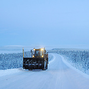 Ian Stewart/Yukon News<br /> A blower heads back to Eagle Plains at dusk.<br /> <br />  &copy; 2013 IAN STEWART PHOTOGRAPHY