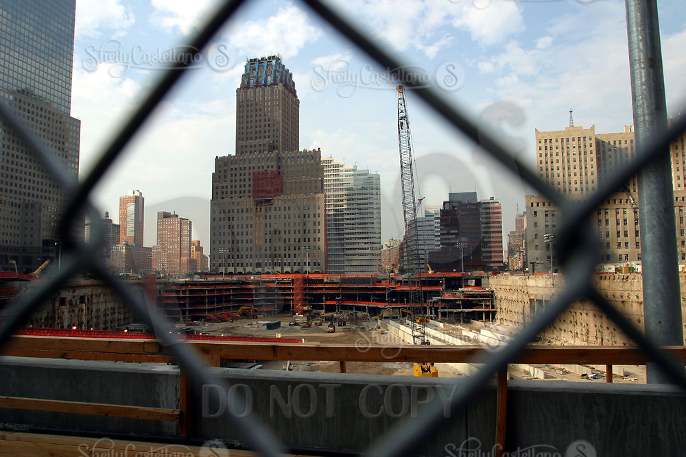 Aug 16, 2002; New York, NY, USA; View of Ground Zero from behind the fence on the south end during a hot summer day almost one year after the attack on America.  Mandatory Credit: Photo by Shelly Castellano/ZUMA Press. (©) Copyright 2002 by Shelly Castellano