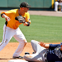 March 22, 2012; Bradenton, FL, USA; Tampa Bay Rays left fielder Chris Gimenez is forced out by Pittsburgh Pirates shortstop Clint Barmes (12) during the top of the sixth inning of a spring training game at McKechnie Field. Mandatory Credit: Derick E. Hingle-US PRESSWIRE
