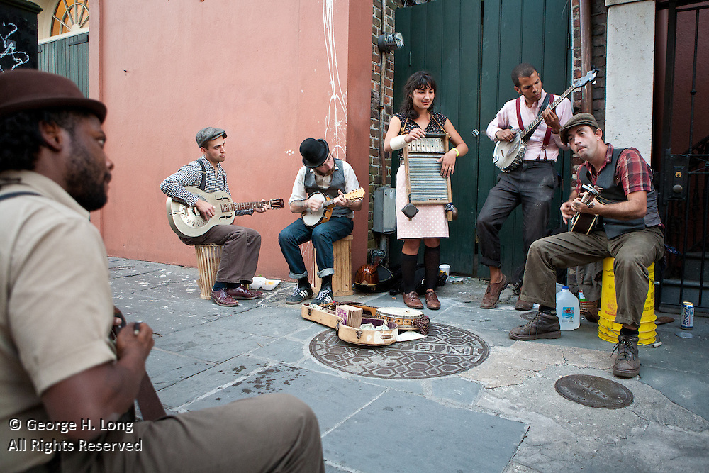 Musicians perform on St. Peter Street in the French Quarter
