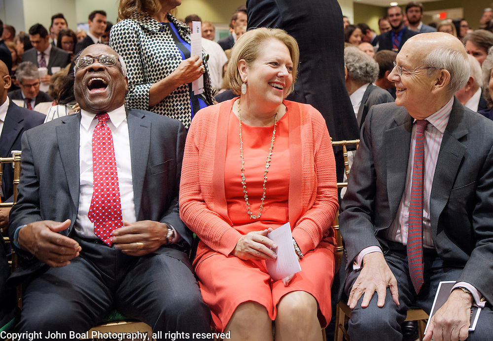 From left, United States Supreme Court Justice, Clarence Thomas, wife, Virginia, and US Supreme Court Justice Stephen Breyer enjoy themselves before the Antonin Scalia Law School Dedication, at the Antonin Scalia School of Law, Arlington, VA, Thursday, October 6,, 2016.