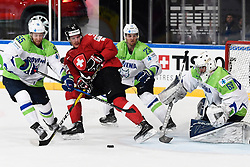 06.05.2017, AccorHotels Arena, Paris, FRA, IIHF WM 2017, Schweiz vs Slowenien, Gruppe B, im Bild Gaetan Haas (SUI) gegen Robert Sabolic (SLO), Luka Vidmar (SLO) und Torhueter Matija Pintaric (SLO) // during the group B match of 2017 IIHF World Championship between Switzerland and Slovenia at the AccorHotels Arena in Paris, France on 2017/05/06. EXPA Pictures © 2017, PhotoCredit: EXPA/ Freshfocus/ Urs Lindt<br /> <br /> *****ATTENTION - for AUT, SLO, CRO, SRB, BIH, MAZ, ITA only*****