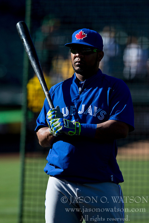 OAKLAND, CA - JULY 05:  Edwin Encarnacion #10 of the Toronto Blue Jays holds a bat with Franklin batting gloves during batting practice before the game against the Oakland Athletics at O.co Coliseum on July 5, 2014 in Oakland, California. The Oakland Athletics defeated the Toronto Blue Jays 5-1.  (Photo by Jason O. Watson/Getty Images) *** Local Caption *** Edwin Encarnacion