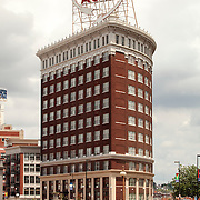 Western Auto Building in evening, vertical photo, downtown Kansas City, Missouri.