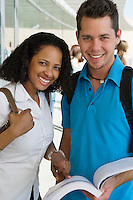 Two students smiling in school, portrait