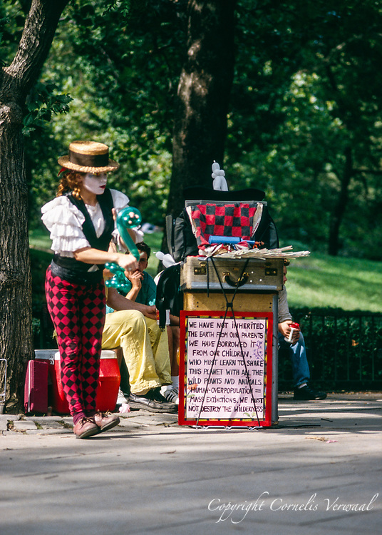 A magical dancing show with Professor Bendeasy & Miss Ooula-La at the statue of Alice in Wonderland in Central Park, New York City, 1992.