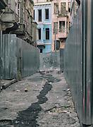 15/10/2013 - Istanbul - Tarlabasi area - A small alley in Tarlabasi. Aluminium gates are all over delimiting the demolition areas.