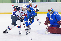 JAN URBAS of Slovenia vs Dennis Adam of Italy during Friendly Ice-hockey match between National teams of Slovenia and Italy on April 5, 2013 in Ice Arena Tabor, Maribor, Slovenia. Slovenia defeated Italy 5-3 after penalty shots. (Photo By Vid Ponikvar / Sportida)
