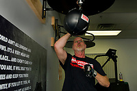 """""""Big Mike"""" Rollins works the speed bag during Downtown Gym's """"Rock Steady Boxing"""" class to fight back against Parkinson's Disease.  (Karen Bobotas/for the Laconia Daily Sun)"""