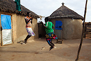 Balila playing with one of her sisters at their home in Tinguri, Ghana.