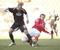 Photo: Aidan Ellis.<br /> Barnsley v Swansea City. Coca Cola League 1. 04/03/2006.<br /> Swansea's lee Trundle is challenged by Barnsley's Martin Devaney