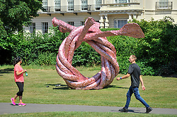 "© Licensed to London News Pictures. 05/07/2017. London, UK. ""Fiddlers Fortune"", 2010, by John Chamberlain.  The Frieze Sculpture festival opens to the public in Regent's Park.  Featuring outdoor works by leading artists from around the world the sculptures are on display from 5 July to 8 October 2017.  Photo credit : Stephen Chung/LNP"