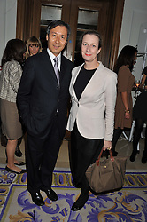 JOSEPH WAN CEO of Harvey Nichols and ANNABEL McAVOY at the 2012 Luxury Briefing Awards in association with Bloomberg held at the Corinthia Hotel, London on 14th March 2012.