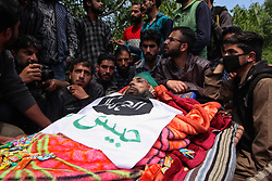 April 25, 2018 - Srinagar, Jammu and Kashmir, India - (EDITORS NOTE: Image depicts death.) People sarround the body of Ishfaq Ahmad a local rebel in south Kashmir's Handura some 45 kilometers from Srinagar the summer capital of Indian administered Kashmir on April 25, 2018. Six people including four rebels and two forces personnel were killed during the gun-battle in the forest area of south Kashmir's Tral ,Police said. (Credit Image: © Faisal Khan/Pacific Press via ZUMA Wire)