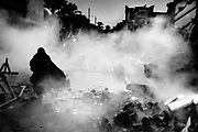 Bam, Iran - dec 2003. Aftershocks and rescue operations left the streets of Bam in a fog of dust. 35 000 people died in the 20 second quake.