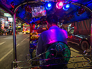 22 OCTOBER 2014 - BANGKOK, THAILAND:   A tuk-tuk, or three wheeled taxi, on Yaowarat Road in Bangkok.     PHOTO BY JACK KURTZ